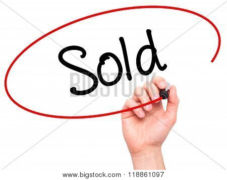 Man Hand Writing Sold With Black Marker On Visual Screen