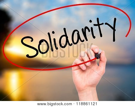 Man Hand Writing Solidarity  With Black Marker On Visual Screen