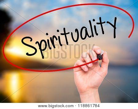 Man Hand Writing Spirituality With Black Marker On Visual Screen