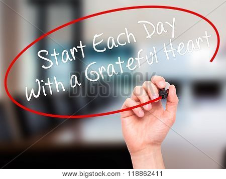 Man Hand Writing Start Each Day With A Grateful Heart With Black Marker On Visual Screen