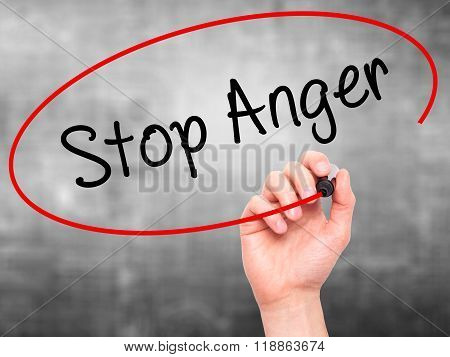Man Hand Writing Stop Anger With Black Marker On Visual Screen