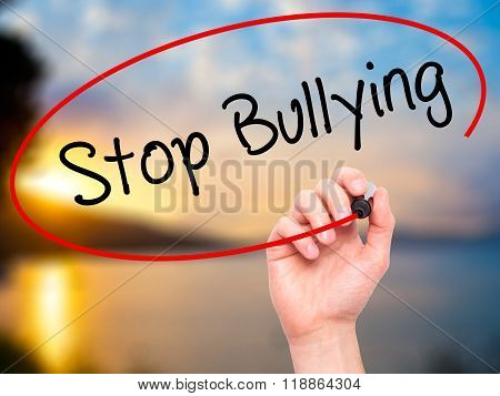 Man Hand Writing Stop Bullying With Black Marker On Visual Screen