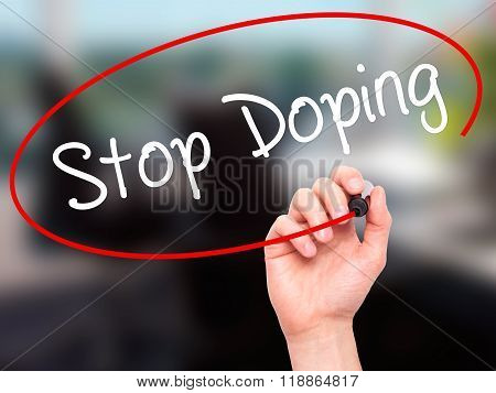 Man Hand Writing Stop Doping With Black Marker On Visual Screen