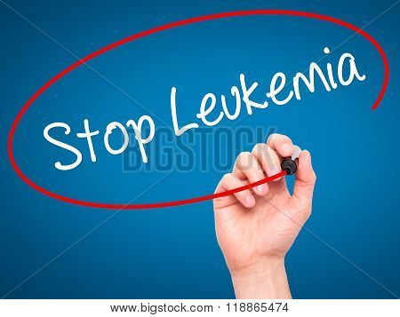 Man Hand Writing  Stop Leukemia With Black Marker On Visual Screen