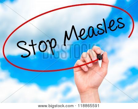 Man Hand Writing Stop Measles  With Black Marker On Visual Screen