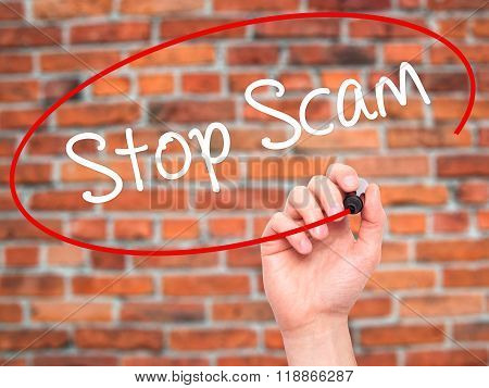 Man Hand Writing Stop Scam With Black Marker On Visual Screen