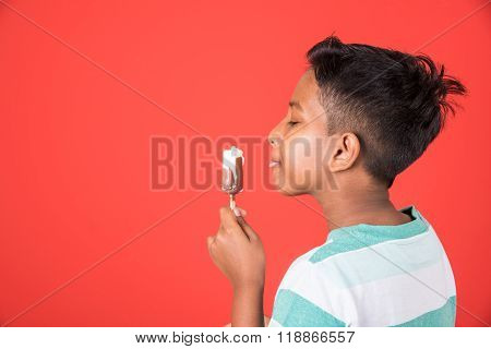 kid enjoying ice cream, indian boy and ice cream, ice cream and india, 10 year boy eating ice cream,