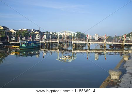 The town bridge across the Thu Bon river in the early morning. Hoi An, Vietnam