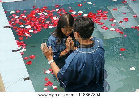 Ceremony Of Baptism. Christian Make Baptism In Water Pond