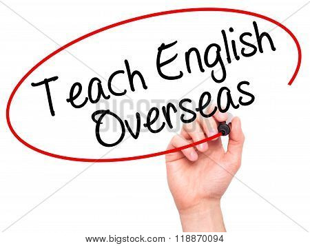 Man Hand Writing Teach English Overseas With Black Marker On Visual Screen