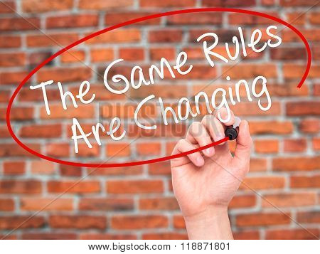 Man Hand Writing The Game Rules Are Changing With Black Marker On Visual Screen
