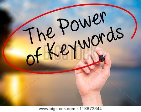 Man Hand Writing The Power Of Keywords With Black Marker On Visual Screen