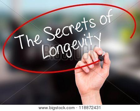 Man Hand Writing The Secrets Of Longevity With Black Marker On Visual Screen