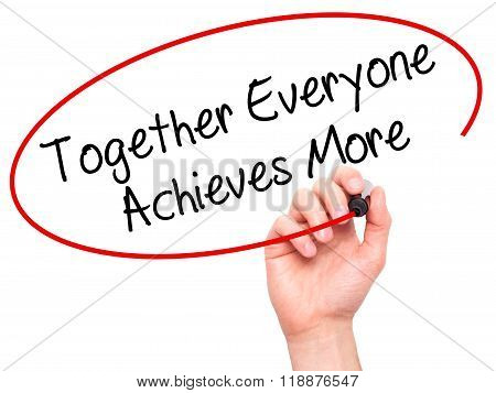 Man Hand Writing Together Everyone Achieves More With Black Marker On Visual Screen