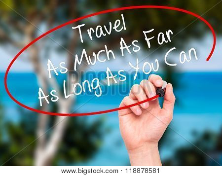 Man Hand Writing Travel As Much As Far As Long As You Can  With Black Marker On Visual Screen
