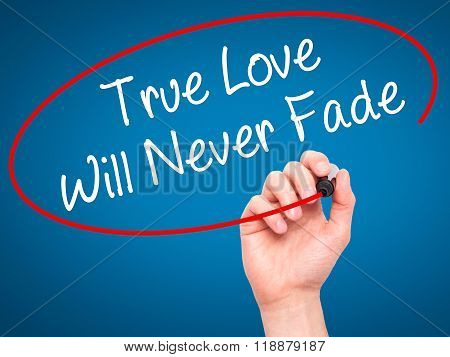 Man Hand Writing True Love Will Never Fade With Black Marker On Visual Screen
