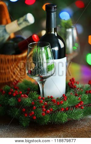 Wine in basket on blurred Christmas tree background