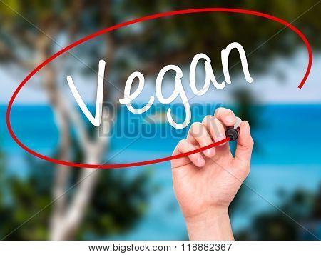 Man Hand Writing Vegan With Black Marker On Visual Screen