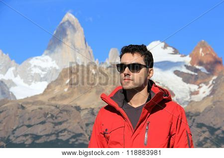 Man and mountain blurred in the background