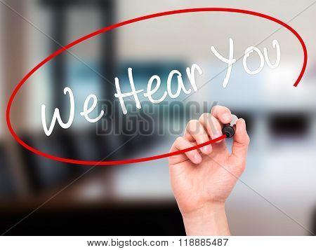 Man Hand Writing We Hear You With Black Marker On Visual Screen