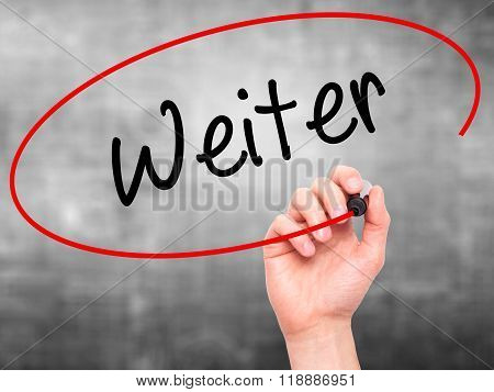 Man Hand Writing Weiter (continue In German)  With Black Marker On Visual Screen