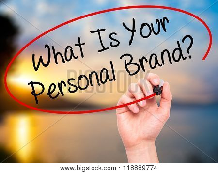 Man Hand Writing What Is Your Personal Brand? With Black Marker On Visual Screen