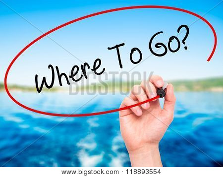 Man Hand Writing Where To Go? With Black Marker On Visual Screen