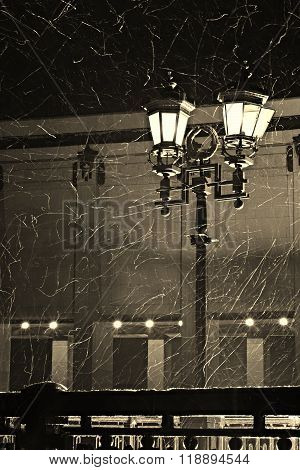 Light street lamp during a snow storm