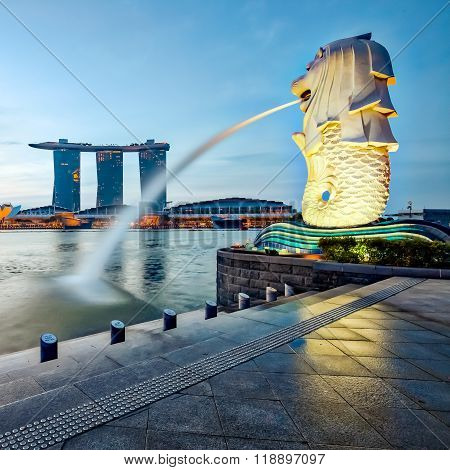 Merlion And View Of Singapore City At Night