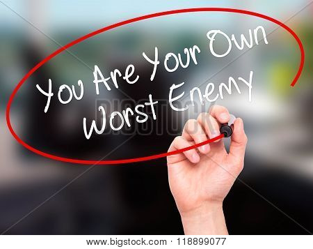 Man Hand Writing You Are Your Own Worst Enemy With Black Marker On Visual Screen