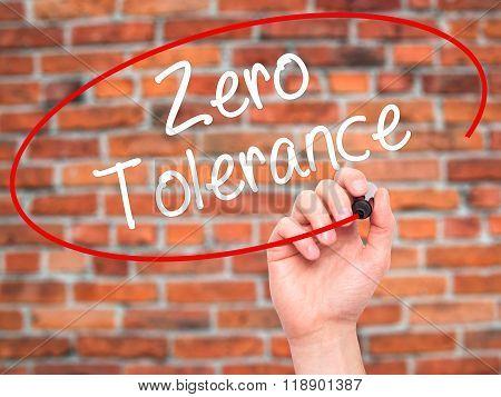 Man Hand Writing Zero Tolerance With Black Marker On Visual Screen