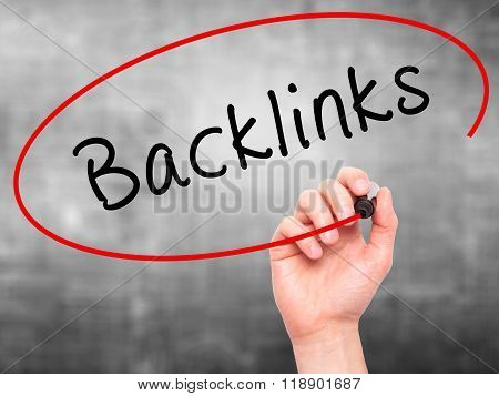 Man Hand Writing Backlinks With Marker On Transparent Wipe Board