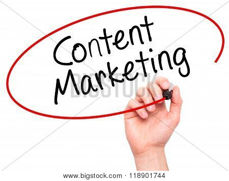 Man Hand Writing Content Marketing With Marker On Transparent Wipe Board