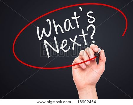 Man Hand Writing What's Next? With Marker On Transparent Wipe Board