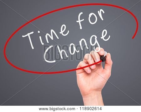 Man Hand Writing Time For Change With Marker On Transparent Wipe Board