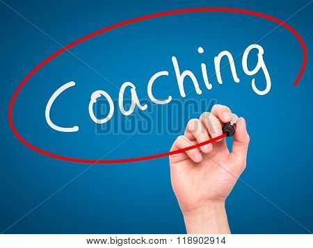 Man Hand Writing Coaching With Marker On Transparent Wipe Board