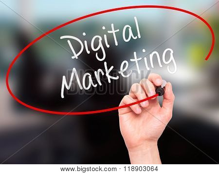 Man Hand Writing Digital Marketing With Marker On Transparent Wipe Board