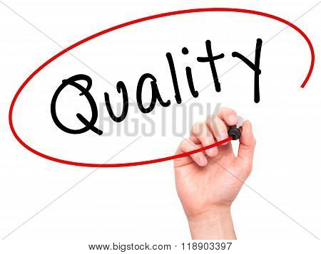 Man Hand Writing Quality With Marker On Transparent Wipe Board