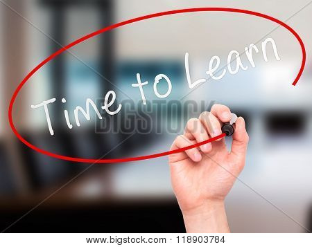 Man Hand Writing Time To Learn With Marker On Transparent Wipe Board