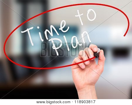 Man Hand Writing Time To Plan With Marker On Transparent Wipe Board