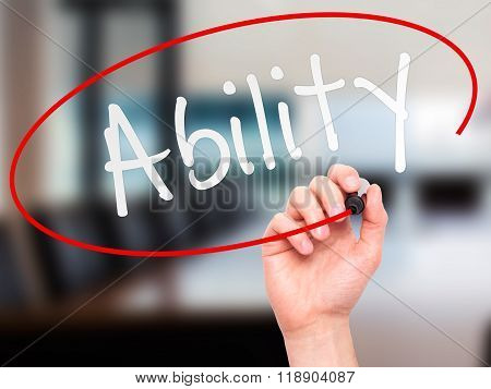 Man Hand Writing Ability With Marker On Transparent Wipe Board
