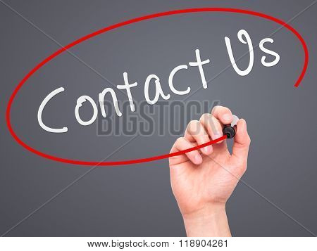 Man Hand Writing Contact Us With Marker On Transparent Wipe Board Isolated On Grey