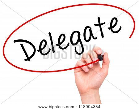 Man Hand Writing Delegate Black Marker On Visual Screen