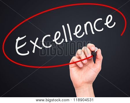 Man Hand Writing Excellence With Marker On Transparent Wipe Board Isolated On Black