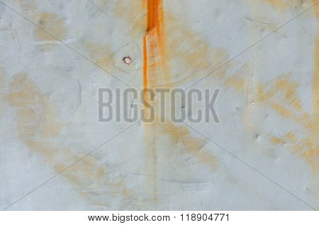 Rusty Streaks And Bullet Hole On Sheet Metal