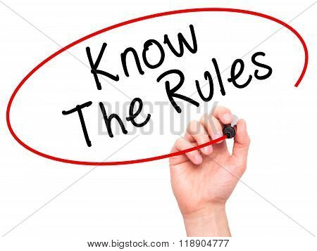 Man Hand Writing Know The Rules With Marker On Transparent Wipe Board Isolated On White