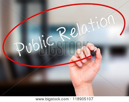 Man Hand Writing Public Relations With Marker On Transparent Wipe Board Isolated On Office