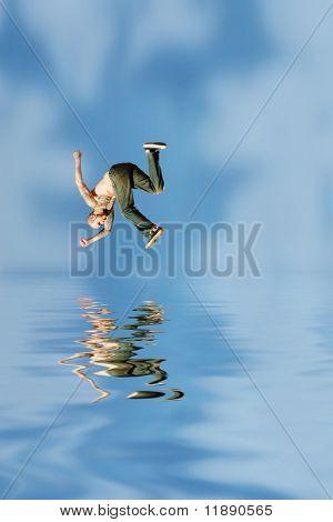 Man jumping on red rocks