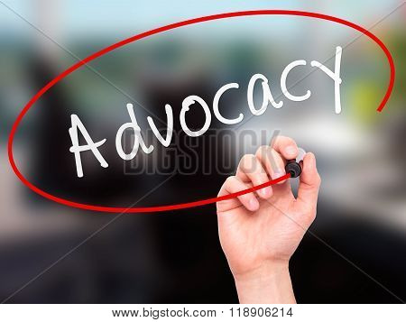 Man Hand Writing Advocacy With Marker On Transparent Wipe Board
