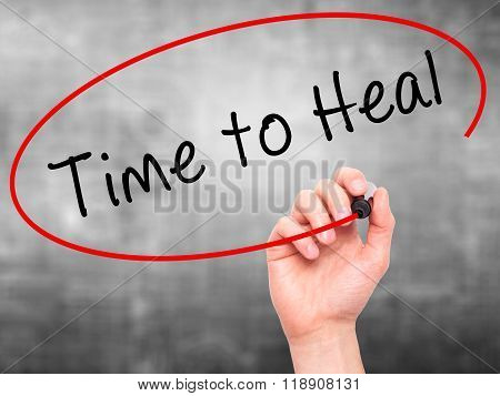 Man Hand Writing Time To Heal With Marker On Transparent Wipe Board